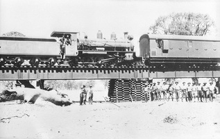 2.1930,North of Hawker possibly Finke River - Work train - NH4 bogie brake van + NM16